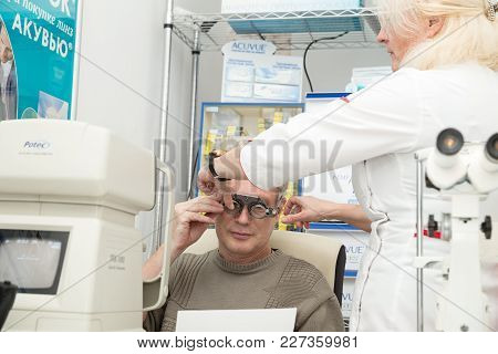 Saint Petersburg, Russia - February 13, 2018: A Woman Optometrist Checks Vision For A Mature Man. Do