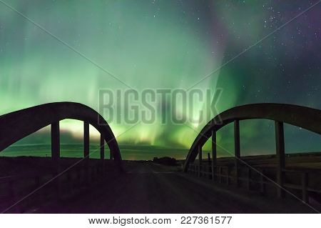 Aurora Borealis Northern Lights Over A Historic Concrete Bridge Near Rush Lake, Saskatchewan, Canada