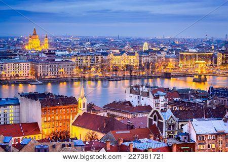 Budapest, Hungary. Szechenyi Chain Bridge And Basilica Sf. Stephen Over Danube River.