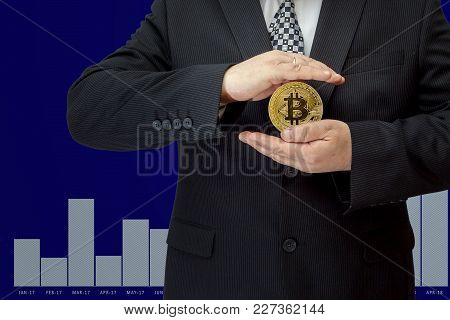 A Wooden Artist-mannequin Holds Bitcoin On A Background Of A Screen With Units And Zeros