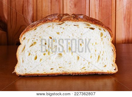Fresh Wheat Bread Slice On Wooden Table