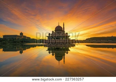Beautiful Sunrise At Putra Mosque, Putrajaya Malaysia With Colorful Clouds And Reflection On The Lak