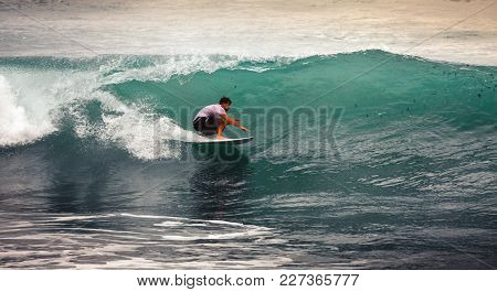 Image Of Surfer On Blue Ocean Wave In Bali, Indonesia. Surfer Riding In Tube. Short Surfboard. Deep