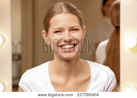 Young woman with natural eyebrows indoors