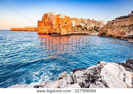 Polignano A Mare, Puglia, Italy. Sunset At Cala Paura Gulf, Province Of Bari, Apulia, Southern Itali