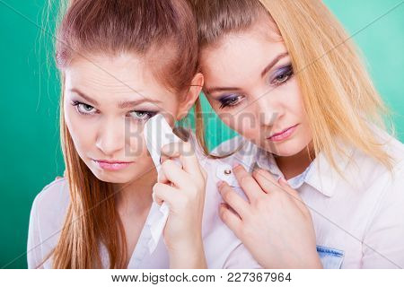 Young Woman Is Sad Crying And Being Consoled By Friend. Girl Comforting Her Sister. Mental Problems
