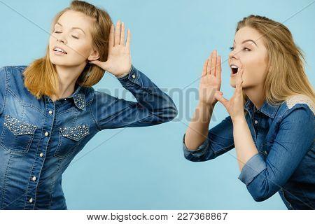 Two Women Talking Gossip, Telling Tales, Girls Talk Having Fun Wearing Jeans Outfit.