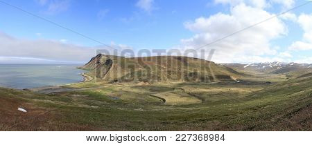 The Valley Of The River Flowing Into The Sea Bay Among The Hills And Tundra On Bering Island