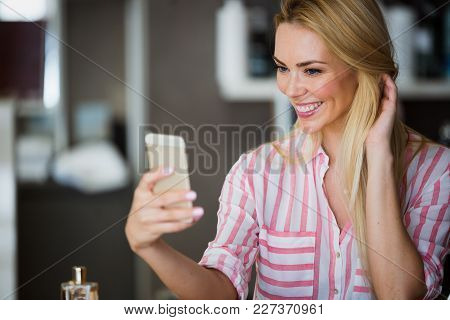 Selfie Time. Attractive Young Woman In Casual Wear Making Selfie By Her Smart Phone And Smiling