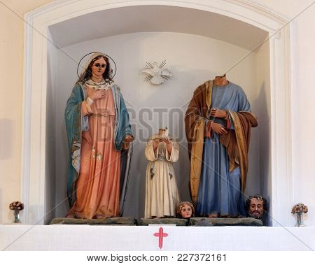 CILIPI, CROATIA - NOVEMBER 08, 2016: Holy Family, figures were ravaged on January 13th,1992, by the Serbian-Montenegrin invaders having previously burnt down Cilipi, church of St. Nicholas in Cilipi