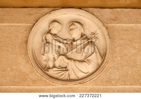 ROME, ITALY - SEPTEMBER 03: Saint Anthony of Padua bass relief in portico of church dei Santi XII Apostoli in Rome, Italy on September 03, 2016.