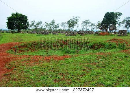 Bomb Craters From The Vietnam War Surround Giant Megalithic Stone Urns At The Plain Of Jars Archaeol