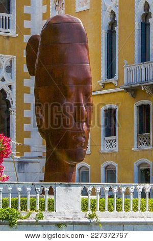 Italy, Venice - June 30, 2013: Monumental Bust Of A Young Girl Rui-rui (7-metre-high,cast Iron) Of S