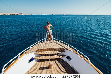 Man On A Yacht. Beautiful View From A Bow Of A Yacht At Seaward. Sailing. Luxury Yachts. Summer Vaca
