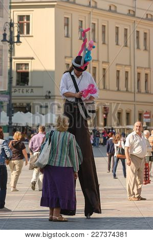 Krakow / Poland - 2012: Main Square And Man On Stilts - Holiday Tourist Life Of Old Town In The Squa