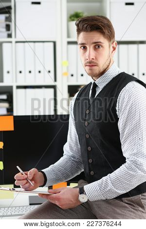 Handsome Man In Suit Hold In Arms Silver Pen And Pad Make Note In Office Smile Portrait. Deal Consul