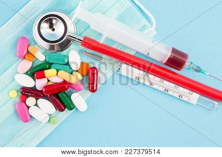General Medical Concept With Syringe Stethoscope Thermometer And Pills.