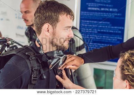 Diver Prepares His Equipment For Diving In The Sea.