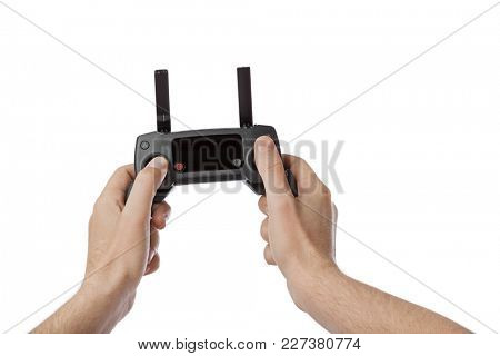 Radio remote control in hands - isolated on white background