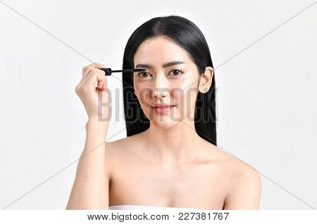 The Concept Of Healthy Beautiful Woman. Beautiful Girl Make Up With Cosmetics. Beautiful Women Use C