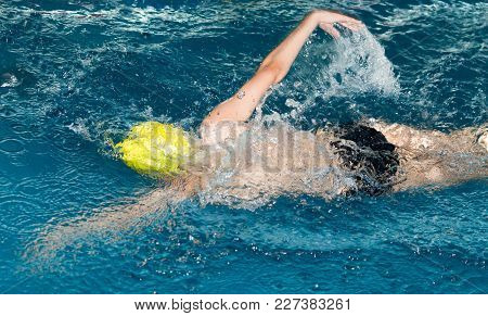 Boy Swimming In The Pool . In The Park In Nature