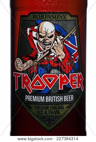 London, Uk - February 14, 2018: Cold Bottle Label Of Trooper Premium British Beer On White Backgroun