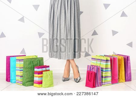 Stylish woman with shopping bags indoors