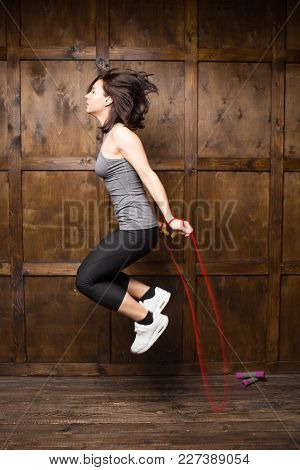 Active Girl Jumping On Skipping Rope. Sport Concept.