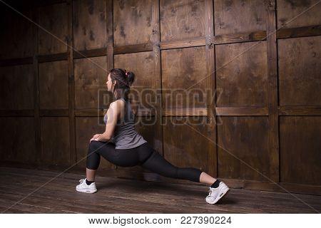 Active Brunette Doing Athletics Home. Sport Concept.