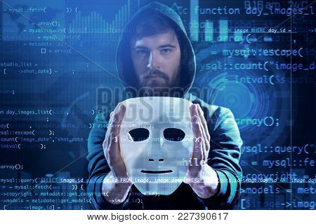 Hacker with mask and code on dark background. Concept of cyber attack and security