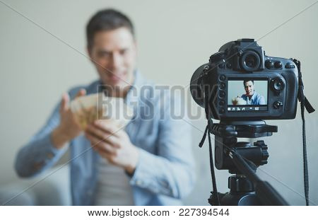 Man Making Video Blog About Money Earning. Focus On Camera.