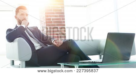 businessman sitting at a coffee table in the lobby