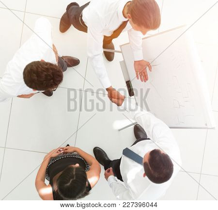 view from the top.the handshake of colleagues before the presentation