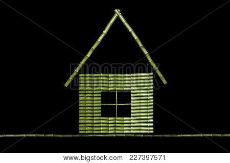 Green House Made Of Bamboo Sticks, Photo On A Black Background