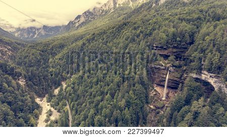 Aerial View Of Mountain Valley With Double Water Fall. Clouds Covering Sky.