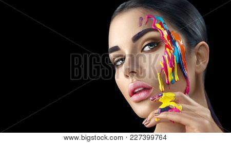 Fashion Model Girl colorful face paint. Beauty fashion art portrait of beautiful woman with flowing liquid paint, abstract makeup. Vivid paint make-up, bright colors Vogue Multicolor creative body art