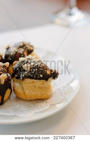 Small Dessert Cakes With Chocolate On The Top