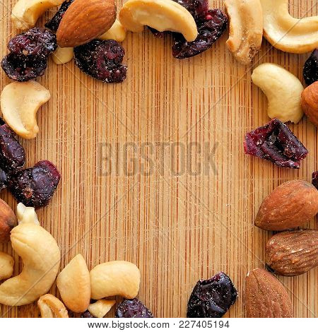 Mixed Fruits And Nuts On Wood Grain Cutting Board, Arranged In Square Image For Social Media, Banner