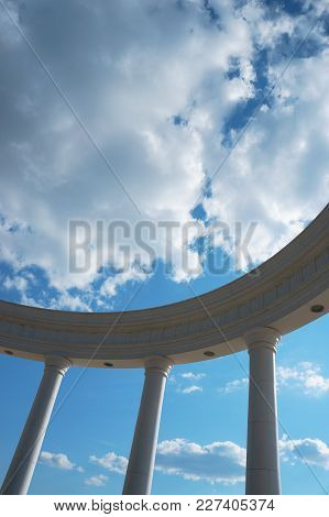 Part Of A Rotunda With Three Columns Against A Cloudy Sky