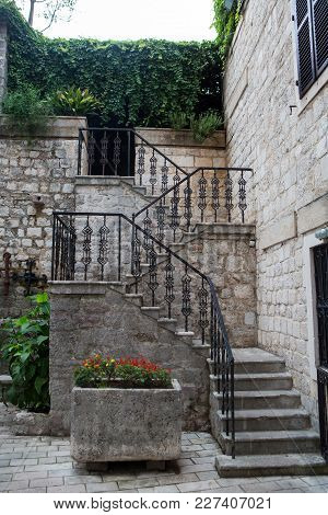 Staircase With Iron Railings And Flowers In Montenegro In Kotor