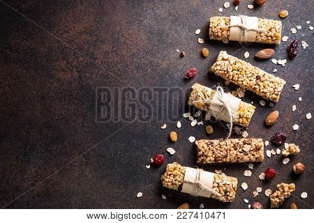 Granola Bars. Fruit And Grain Granola Bars On Dark Stone Table. Top View Copy Space. Diet Food, Vega