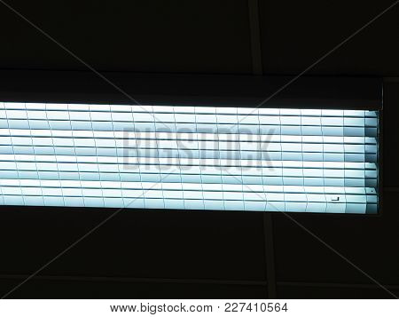 Lighting Ceiling Panels. Fluorescent Lamps On The Modern Ceiling. Luminous Ceiling Of Square Tiles.