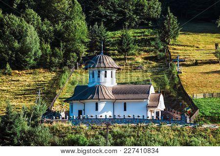 Small Orthodox Church In The Mountains, Transylvania, Romania