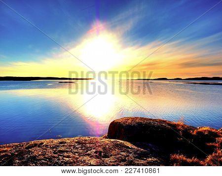 Amazing Fire Sunrise On The Sea Bay, Rocky Shore. Hot Sunset At Rocky Horizon