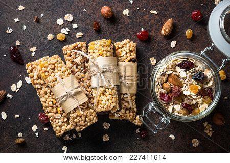 Granola Bars. Fruit And Grain Granola Bars On Dark Stone Table. Top View. Diet Food, Vegan Food.