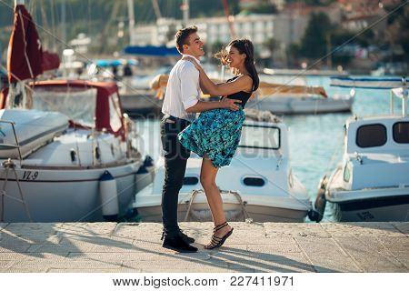 Happy Couple In Love On A Summer Holiday Vacation.celebrating Holiday,anniversary,engagement. Woman