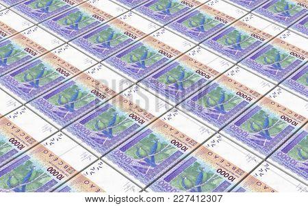 West African CFA francs bills stacked background. 3D illustration.