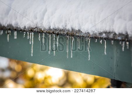 Roof Icicles Melting In Spring Close Up
