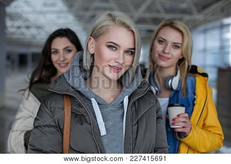 Portrait Of Smiling Lady Looking At Camera. Focus On Her. Friends On Background
