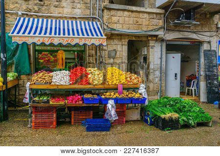 Haifa, Israel - February 17, 2018:  Scene Of Wadi Nisnas Market, With Various Vegetables On Sale, In